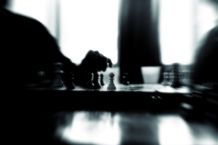 Chessman standing alone in front line, in a game of chess